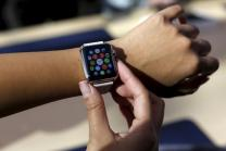 A customer looks over an Apple Watch in Palo Alto
